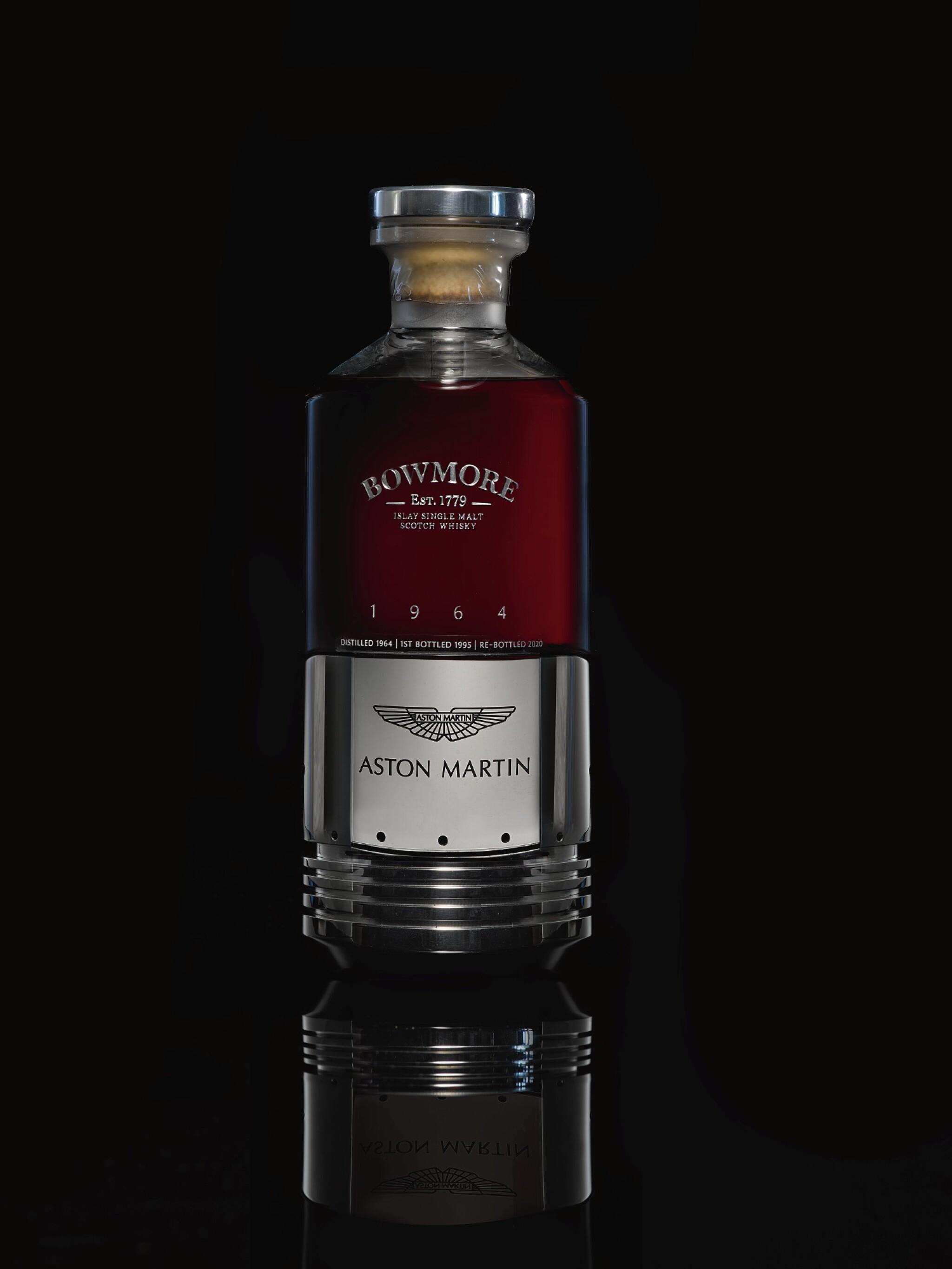 View full screen - View 1 of Lot 1. Black Bowmore Aston Martin DB5 Whisky 49.6 abv 1964 (1 BT75).