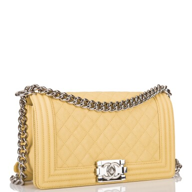View 2. Thumbnail of Lot 84. Chanel Yellow Quilted Old Medium Boy Bag of Caviar Leather with Silver Hardware.