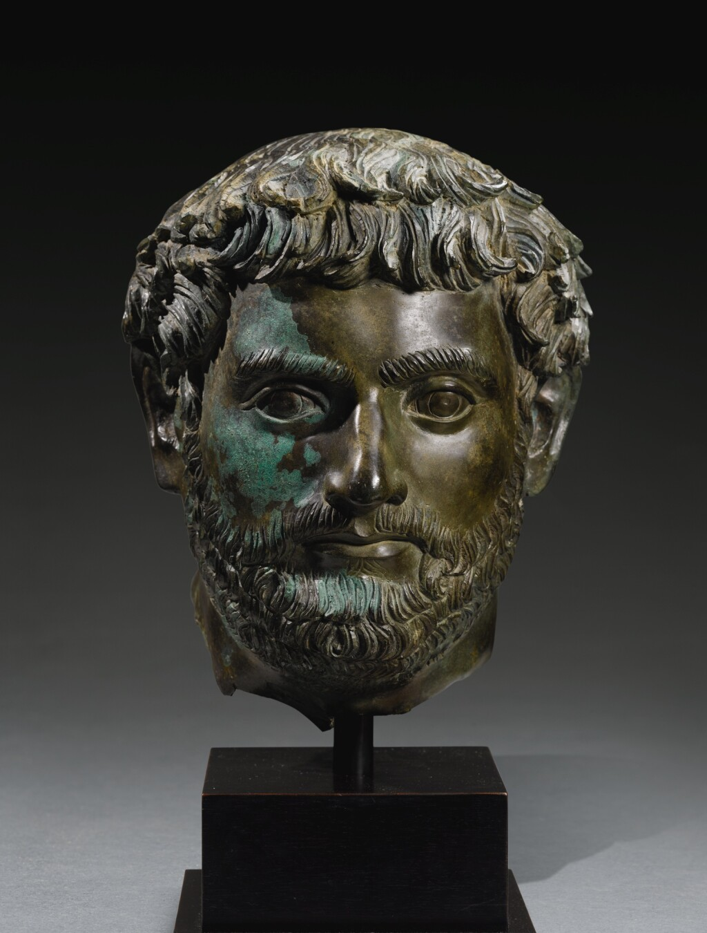 A ROMAN BRONZE PORTRAIT HEAD OF A MAN, HADRIANIC, CIRCA EARLY 2ND CENTURY A.D.
