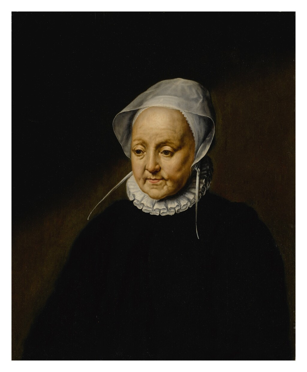 DUTCH SCHOOL, CIRCA 1586   PORTRAIT OF AN OLD WOMAN, AGED 53, HALF-LENGTH, WEARING A BLACK COSTUME WITH A WHITE CAP