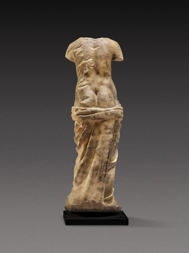 View 4. Thumbnail of Lot 83. A Roman Marble Figure of a Nymph holding a Shell , circa 2nd Century A.D..