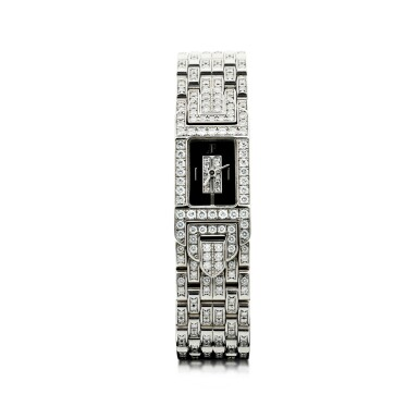 View 1. Thumbnail of Lot 74. A LADY'S WHITE GOLD AND DIAMOND SET BRACELET WATCH WITH ONYX AND DIAMOND-SET DIAL, CIRCA 2005.