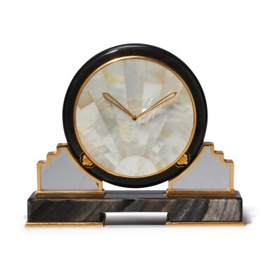 View 1. Thumbnail of Lot 56. AN OBSIDIAN, MOTHER OF PEARL, ROCK CRYSTAL AND GILT BRASS DESK TIMEPIECE, CIRCA 1980.