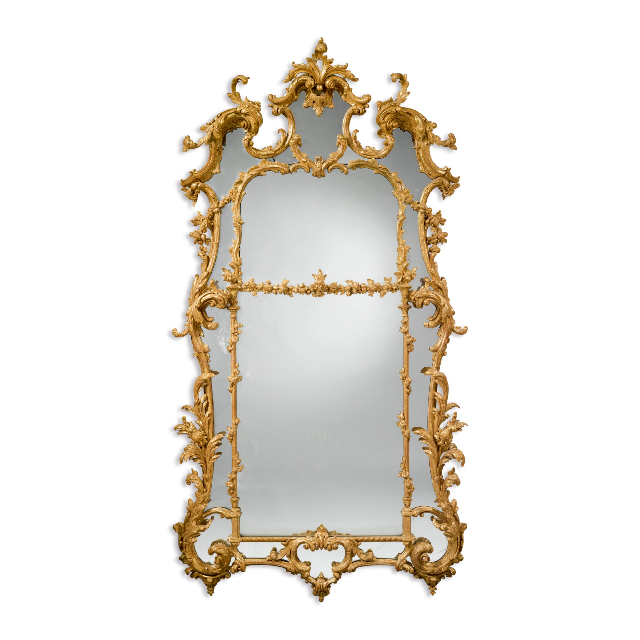 View 1 of Lot 246. A GEORGE III CARVED AND GILTWOOD MIRROR, CIRCA 1765.