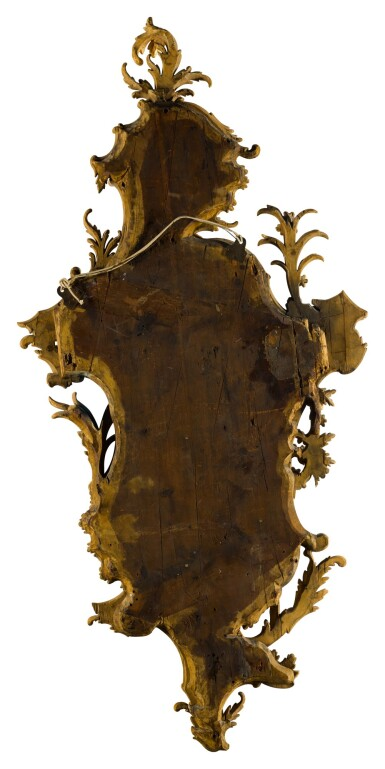 View 3. Thumbnail of Lot 44. A pair of late George II carved giltwood mirrors, circa 1755, in the manner of William and John Linnell.
