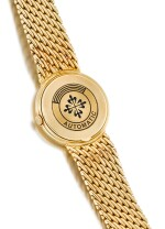 PATEK PHILIPPE  |  REFERENCE 3945,  A YELLOW GOLD PERPETUAL CALENDAR BRACELET WATCH WITH MOON PHASES, 24 HOURS AND LEAP YEAR INDICATION, CIRCA 1993
