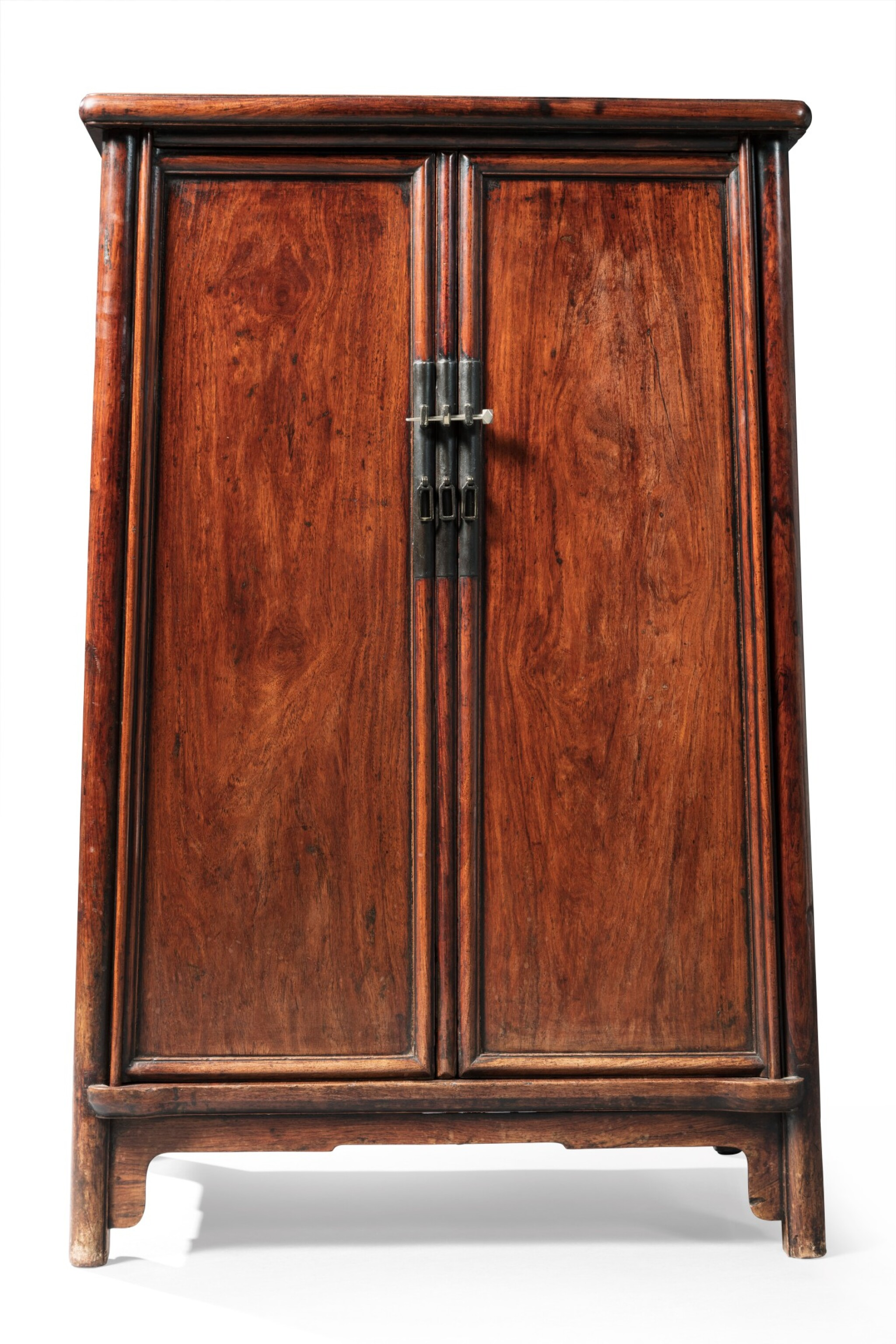 View full screen - View 1 of Lot 24. A huanghuali rounded-corners cabinet, yuanjiao gui Ming dynasty, 17th century   明 十七世紀 黃花梨圓角櫃.
