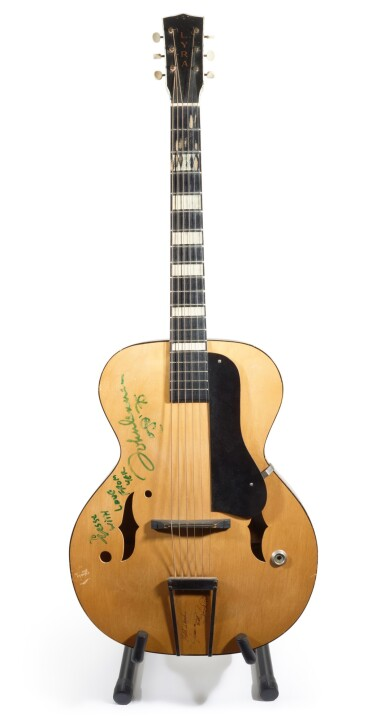 View 1. Thumbnail of Lot 60. JOHN LENNON   semi-acoustic guitar from the collection of Jesse Ed Davis, inscribed by Lennon, 1975.