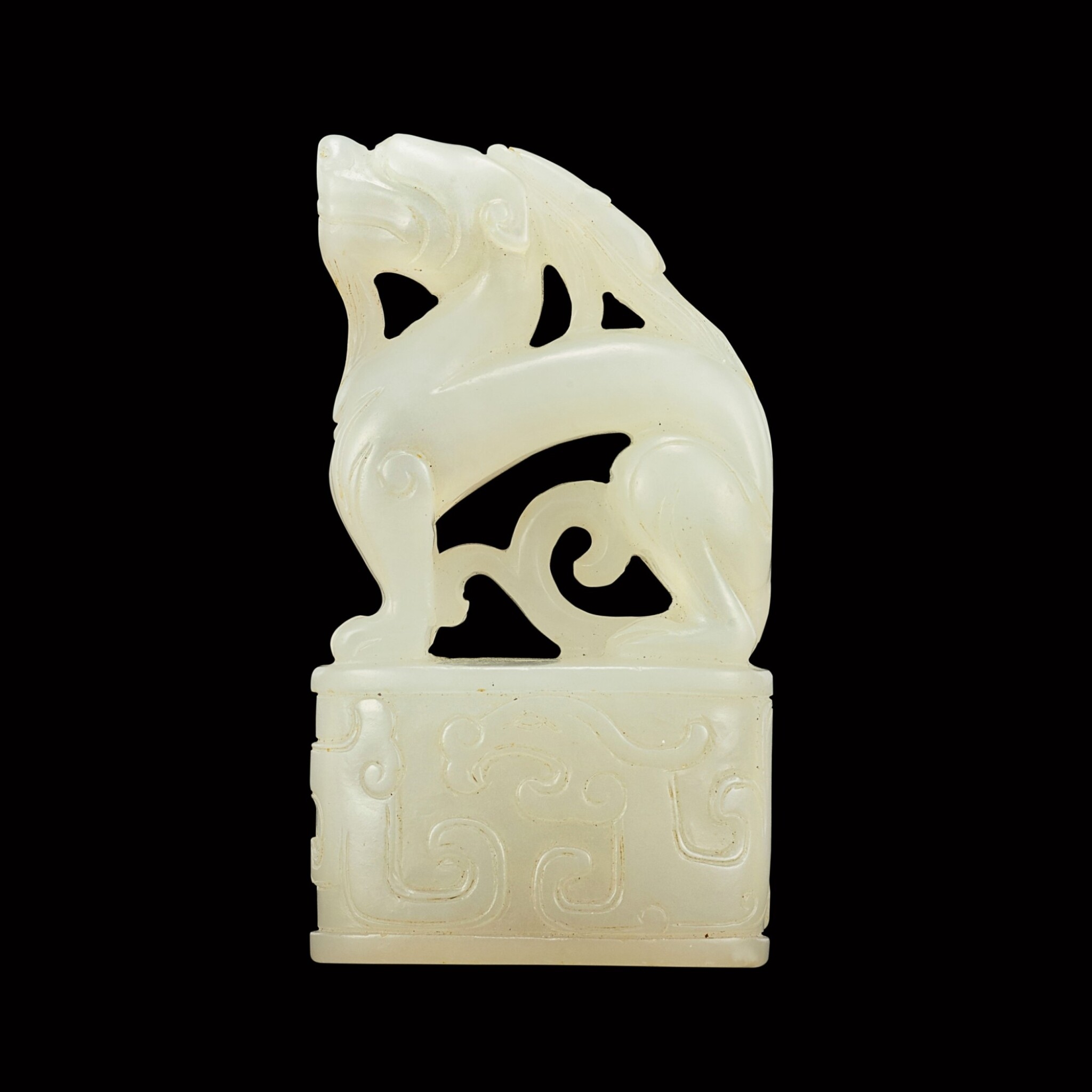View full screen - View 1 of Lot 145. A white jade archaistic 'dragon' seal Qing dynasty, Kangxi period | 清康熙 白玉龍鈕印.