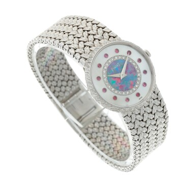 View 4. Thumbnail of Lot 109. Reference 9005 D 2 A white gold, mother-of-pearl, opal, diamond and ruby-set bracelet watch, Circa 1975.