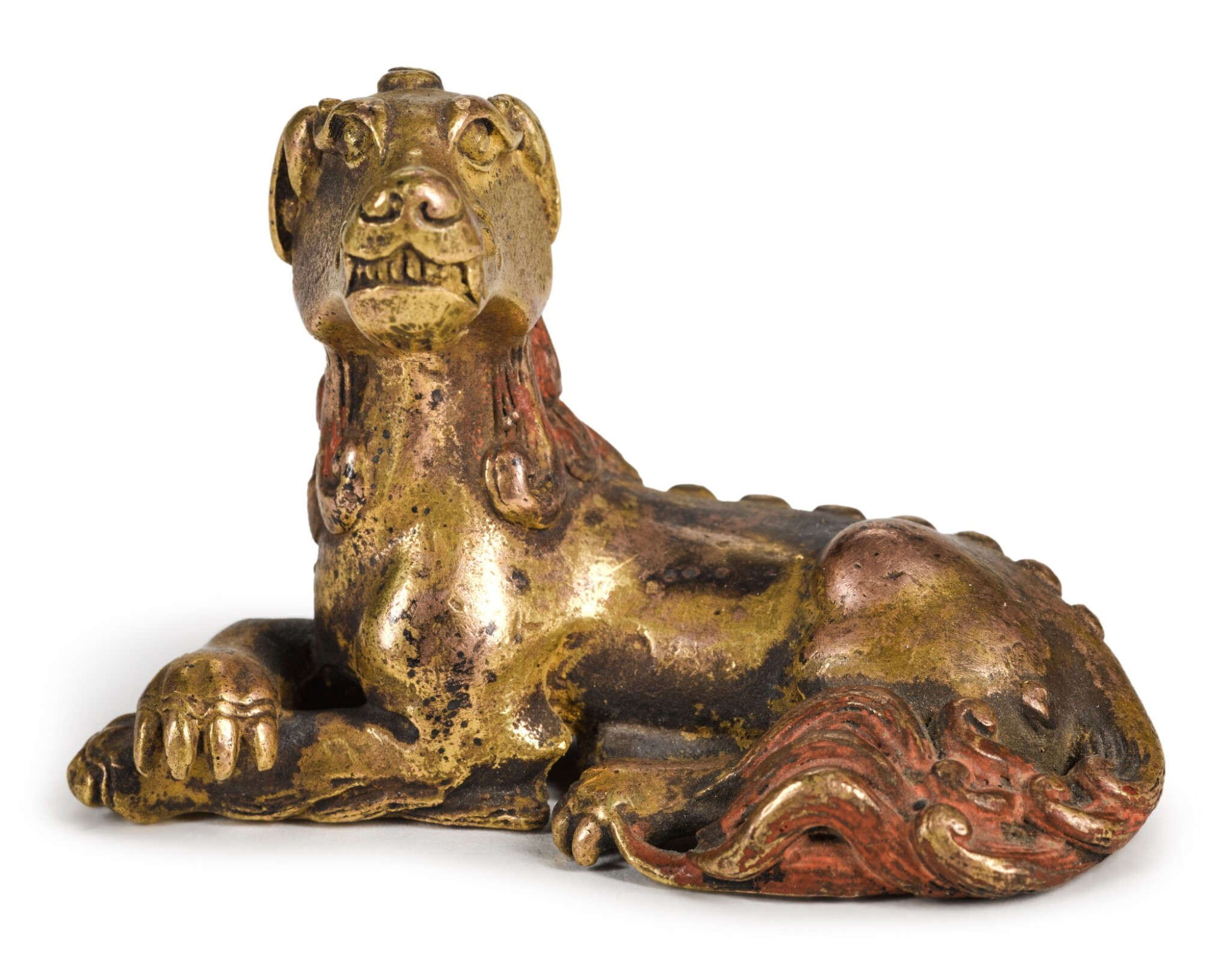 View full screen - View 1 of Lot 73. A GILT-BRONZE 'MYTHICAL BEAST' PAPERWEIGHT | 17TH/18TH CENTURY | 十七/十八世紀 鎏金銅瑞獸鎮紙.