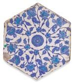 AN IZNIK HEXAGONAL BLUE AND TURQUOISE POTTERY TILE, TURKEY, FIRST-HALF 16TH CENTURY