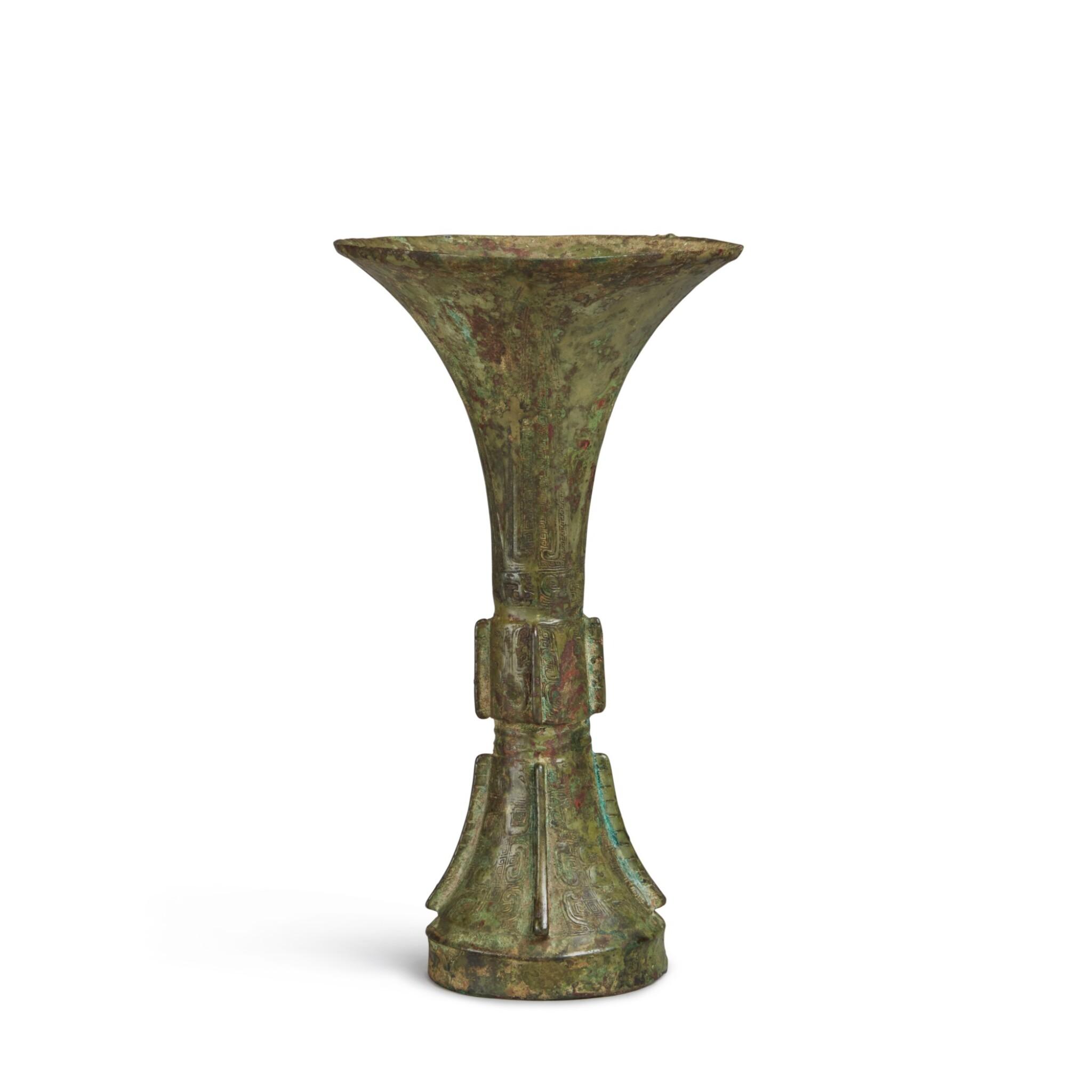 View full screen - View 1 of Lot 2. An archaic bronze ritual wine vessel (Gu), Late Shang dynasty | 商末 青銅饕餮紋觚.