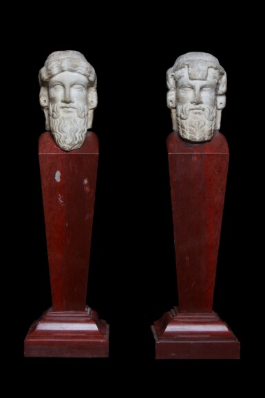 View 3. Thumbnail of Lot 97. Two Roman Marble Janiform Herm Heads, circa 2nd century A.D., mounted as a pair on red marble shafts, probably in the 19th Century, circa 1st Century A.D..