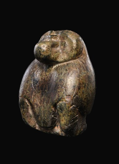 View 1. Thumbnail of Lot 56. AN EGYPTIAN SERPENTINE FIGURE OF A BABOON, 26TH/30TH DYNASTY, 664-342 B.C..