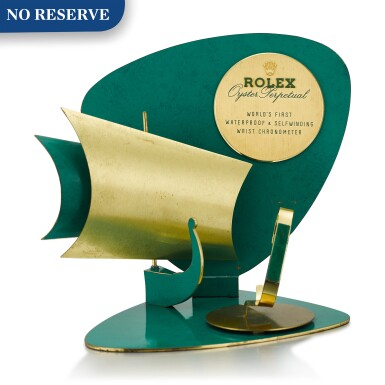 ROLEX | OYSTER PERPETUAL A GILT BRASS AND GREEN ENAMEL RETAILER'S WINDOW DISPLAY, CIRCA 1960