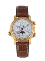 JAEGER-LECOULTRE   GRAND REVÉIL, REF 180.1.99 YELLOW GOLD PERPETUAL CALENDAR WRISTWATCH WITH MOON PHASES, ALARM, 24-HOUR AND YEAR INDICATION CIRCA 1989