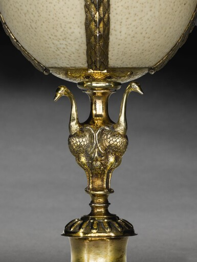 View 2. Thumbnail of Lot 3. A German silver-gilt mounted ostrich egg cup and cover, Andreas Klette, Torgau, circa 1622.