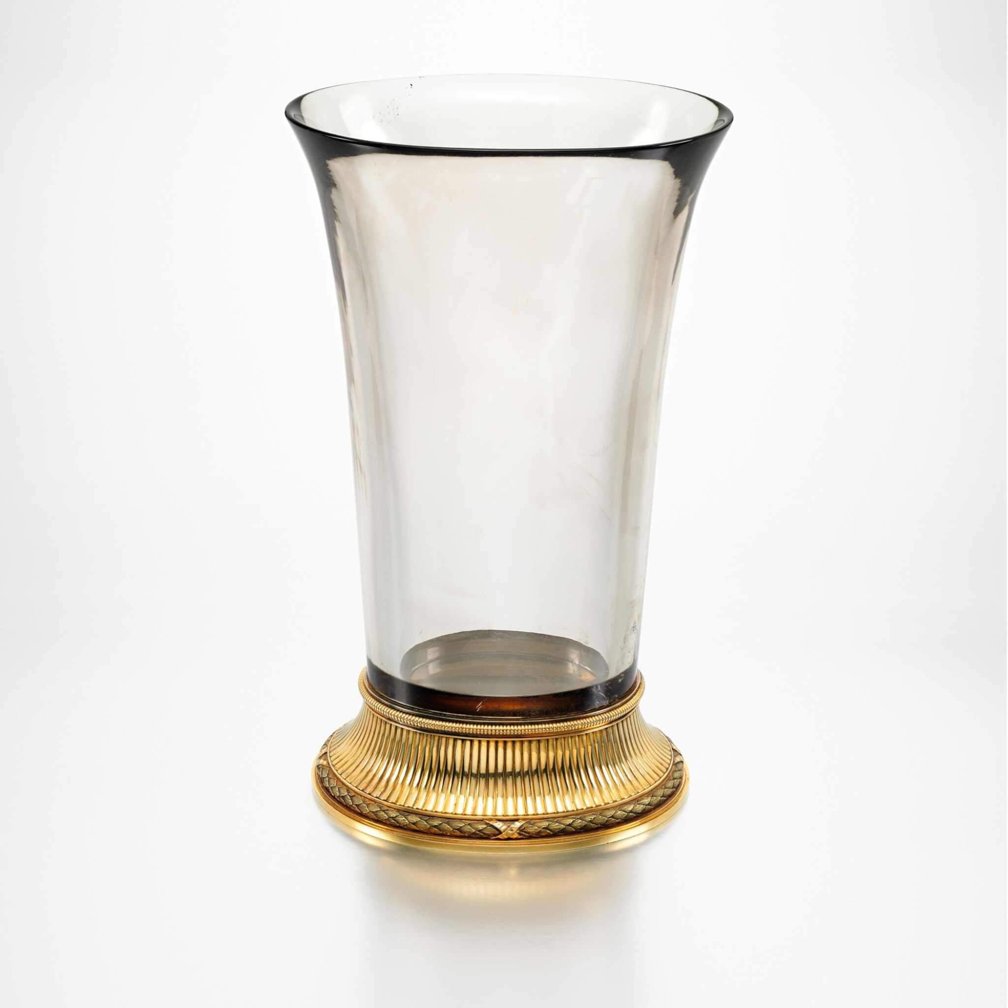 View full screen - View 1 of Lot 12. THE IMPERIAL 'BALLETTA' VASE: A RARE AND IMPORTANT FABERGÉ TWO-COLOUR GOLD-MOUNTED SMOKY TOPAZ VASE, WORKMASTER MICHAEL PERCHIN, ST PETERSBURG, 1899-1903.