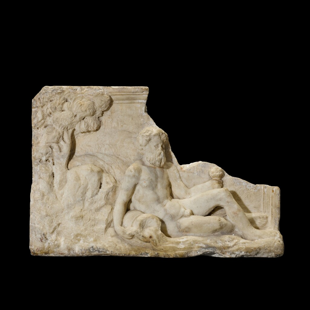 A FRAGMENTARY MARBLE RELIEF OF A RIVER GOD, CIRCA 1ST CENTURY A.D., OR AFTER THE ANTIQUE