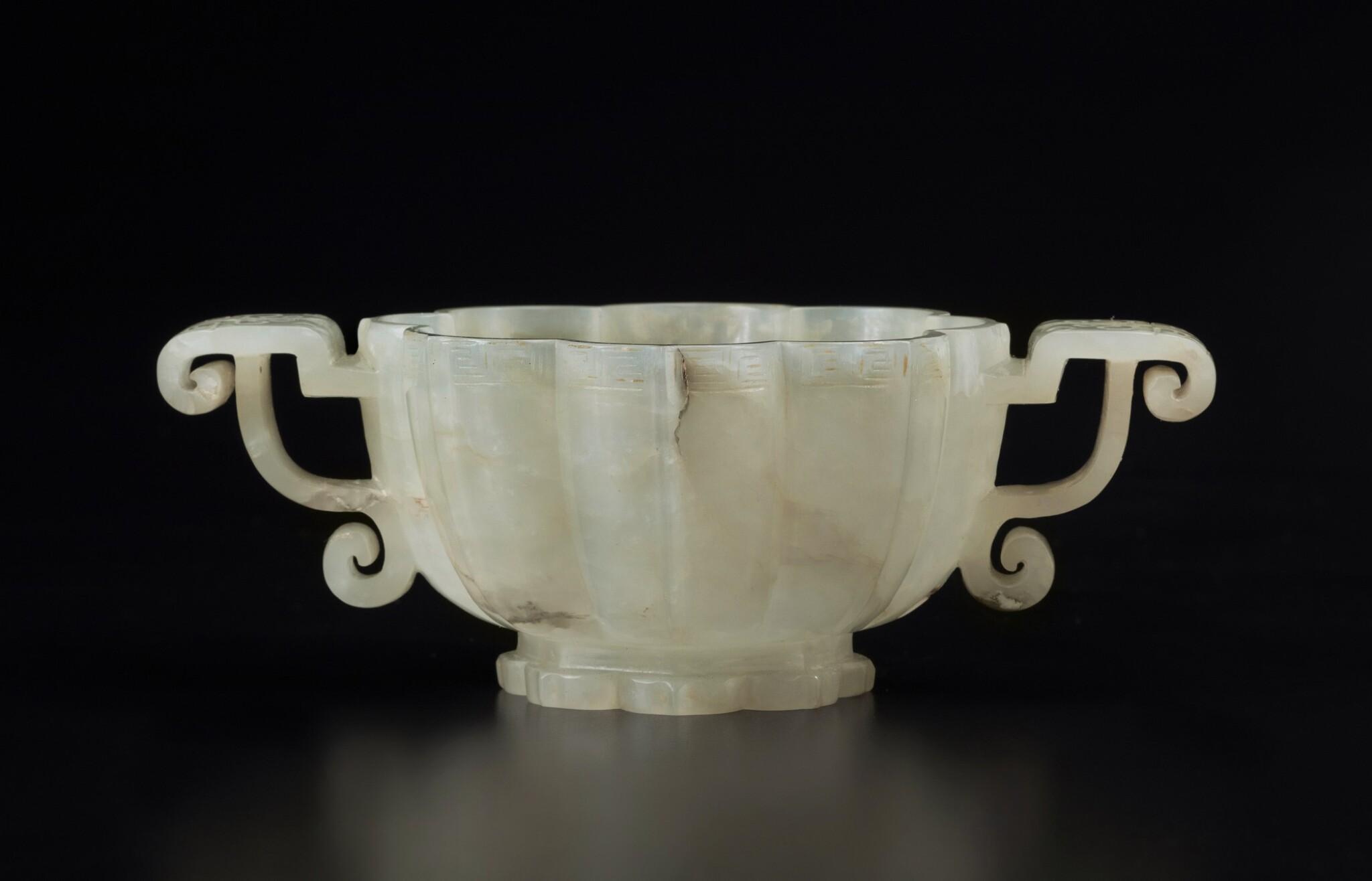 View full screen - View 1 of Lot 51. A pale celadon jade lobed cup, Ming dynasty | 明 青白玉菱花式雙耳盃.