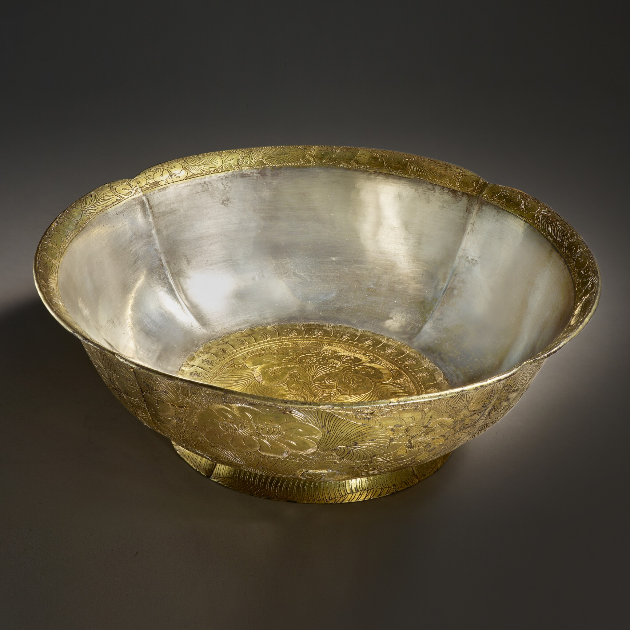 View full screen - View 1 of Lot 202. A superb and important parcel-gilt silver 'lotus and pomegranate' bowl, Tang dynasty   唐 銀局部鎏金石榴蓮花紋花式大盌.