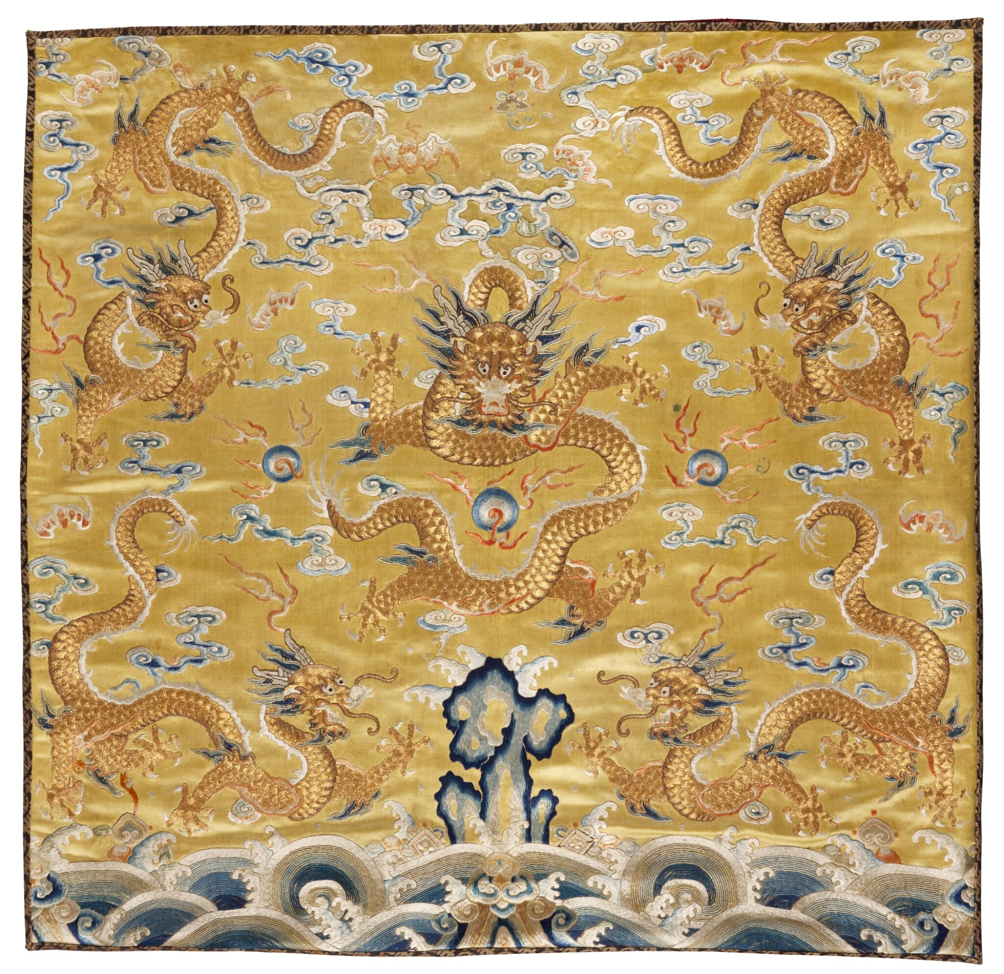View full screen - View 1 of Lot 29. AN IMPERIAL YELLOW-GROUND EMBROIDERED SILK CUSHION COVER, QING DYNASTY, QIANLONG PERIOD  清乾隆 黃地鍛綉五龍趕珠紋墊面.