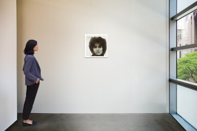View 2. Thumbnail of Lot 12. DIANE ARBUS | 'PUERTO RICAN WOMAN WITH A BEAUTY MARK, N. Y. C.'.