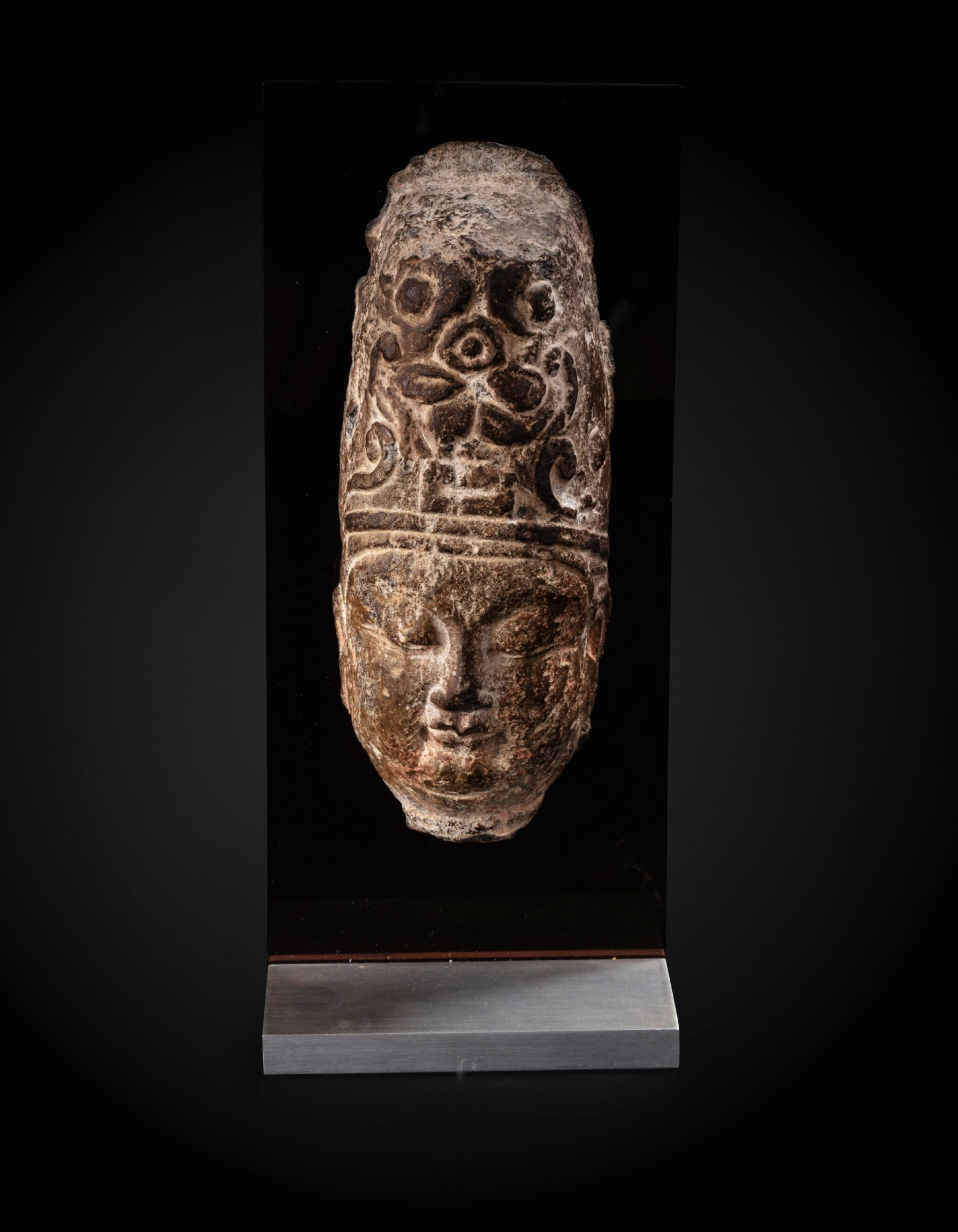 View full screen - View 1 of Lot 23. An important fragmentary relief head of an attendant Sui dynasty-Tang dynasty, ca. 7th century   隋至唐 約七世紀 石浮雕神首殘件.