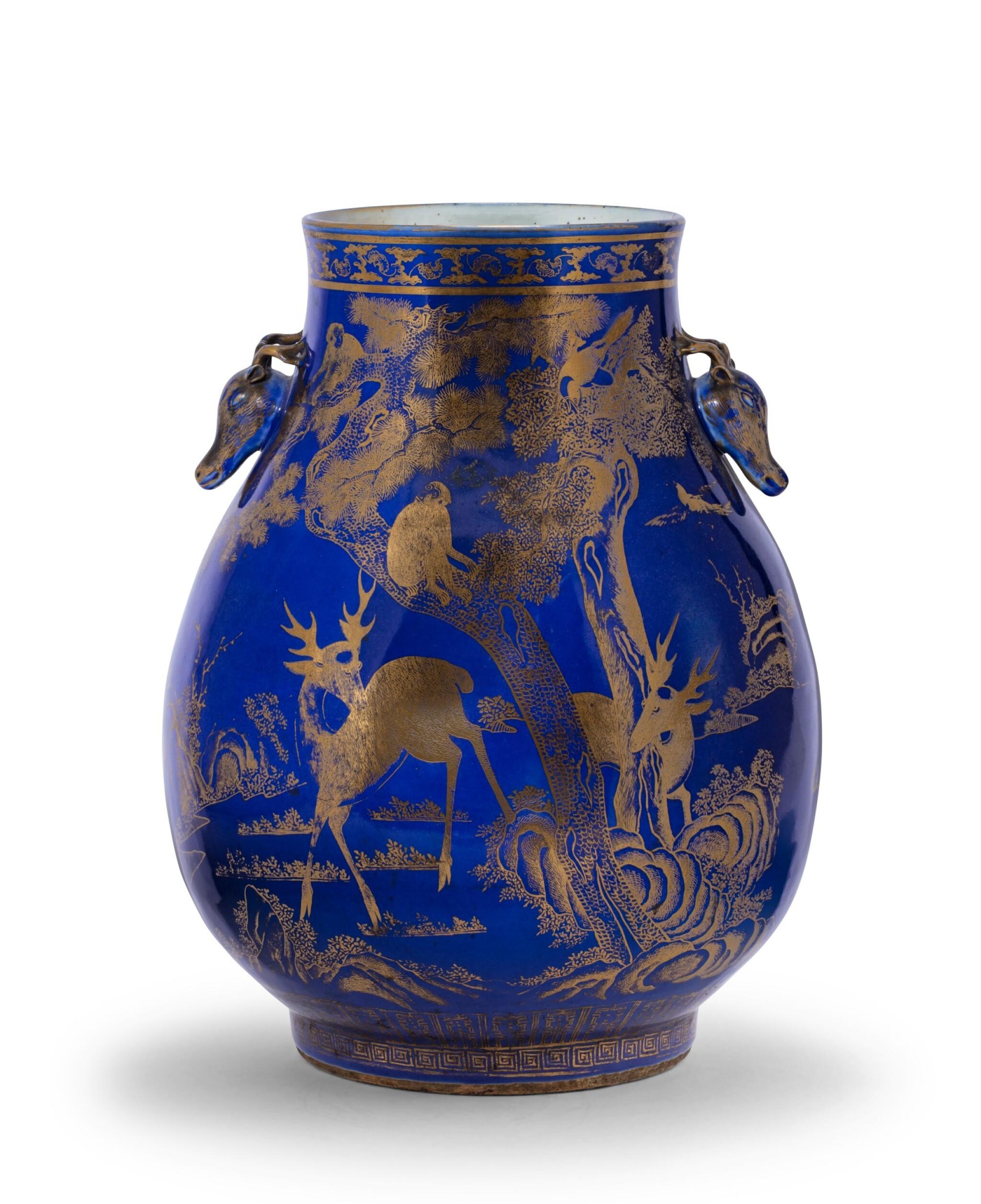 View 1 of Lot 235. Vase en porcelaine à fond bleu émaillé or à décor de daims, hu Dynastie Qing, XIXE siècle | 清十九世紀 霽藍地描金瑞獸紋鹿首耳尊 | A gilt-decorated blue-ground 'deer' vase, hu, Qing Dynasty, 19th century.