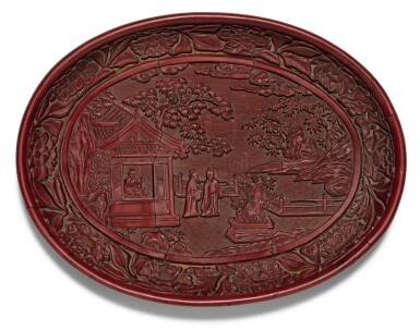 View 1. Thumbnail of Lot 139. A RARE AND FINELY CARVED CINNABAR LACQUER DISH YONGLE MARK AND PERIOD | 明永樂 剔紅賞石圖橢圓盤 《大明永樂年製》款.