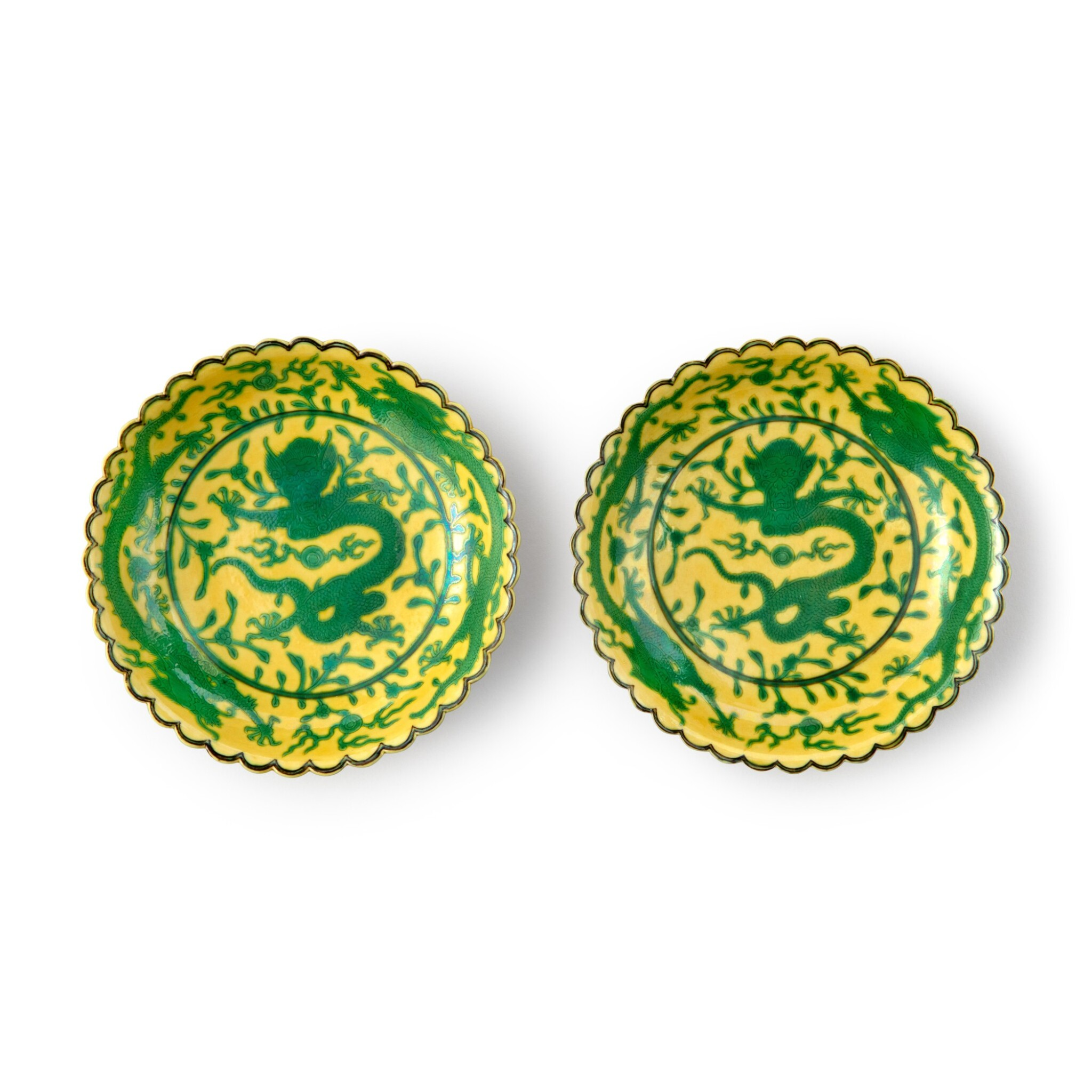 View full screen - View 1 of Lot 71. A pair of yellow-ground green-enameled 'dragon' dishes, Seal marks and period of Qianlong | 清乾隆 黃地綠彩趕珠龍紋花口小盤一對 《大清乾隆年製》款.