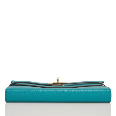 View 4. Thumbnail of Lot 23. Hermès Blue Paon Chevre Leather Kelly Longue Wallet.