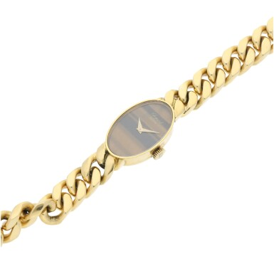View 6. Thumbnail of Lot 221. REFERENCE 5026/1 A LADY'S YELLOW GOLD BRACELET WATCH WITH TIGER EYE DIAL, CIRCA 1990'S.