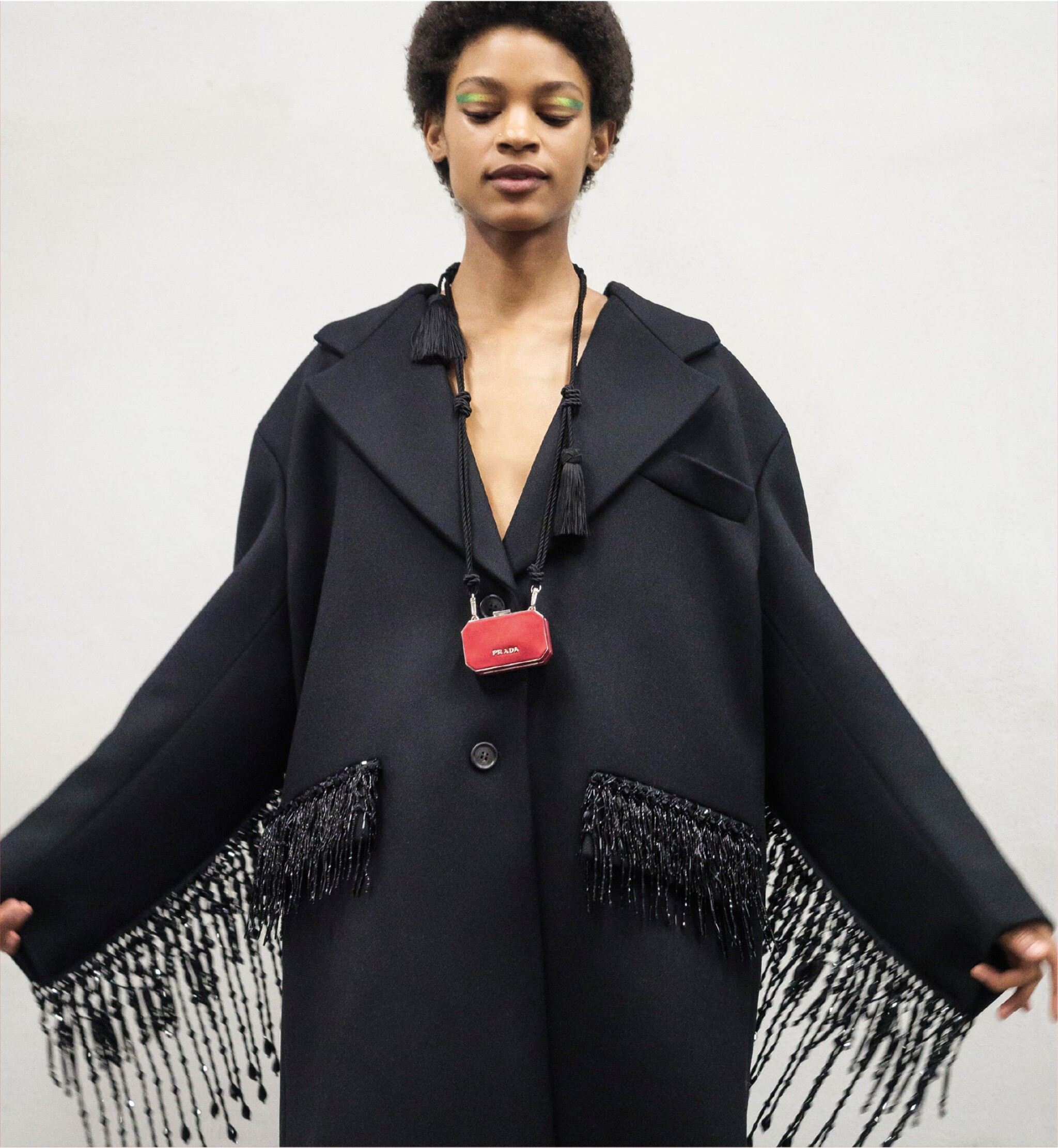 View full screen - View 1 of Lot 8. PRADA | WOOL BEADED FRINGE COAT AND VANITY NECKLACE,   WORN BY THERESA HAYES.