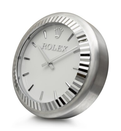 View 2. Thumbnail of Lot 199. INDUCTA MANUFACTURE FOR ROLEX | A METALWORK WALL CLOCK, CIRCA 2010.