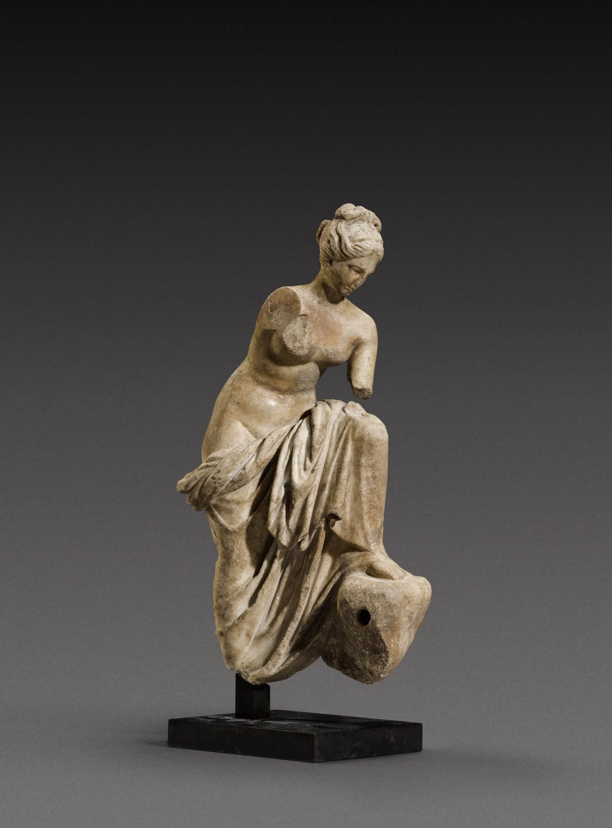 View full screen - View 1 of Lot 71. A Roman Marble Fountain Figure of a Nymph, circa 1st Century A.D..