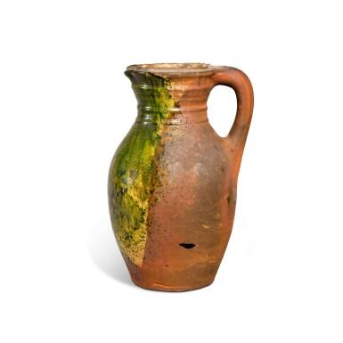 View 3. Thumbnail of Lot 78. A Borderware green-glazed pottery jug, probably 15th century.
