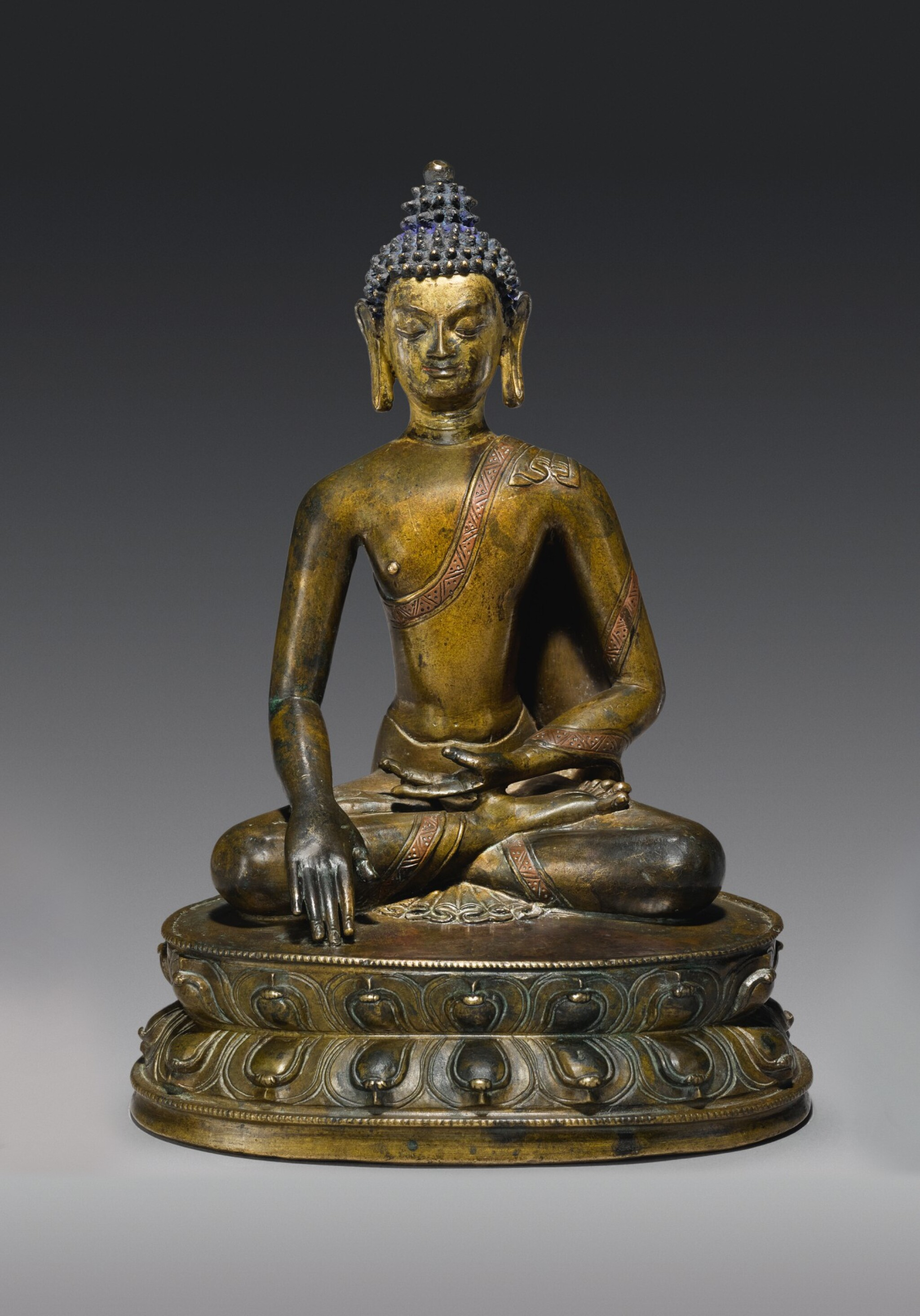 View full screen - View 1 of Lot 326. A COPPER ALLOY FIGURE OF BUDDHA SHAKYAMUNI WITH COPPER INLAY,  TIBET, 14TH CENTURY.