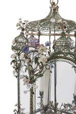 A FRENCH LOUIS XV SILVERED BRONZE PENTAGONAL LANTERN DECORATED WITH CONTINENTAL PORCELAIN FLOWERS AND GREEN-PAINTED METAL TRELLISWORK, THE LANTERN MID-18TH CENTURY, THE FLOWERS AND METALWORK 18TH CENTURY AND LATER