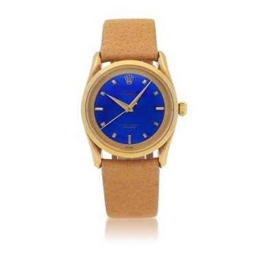 View 1. Thumbnail of Lot 33. 'BOMBAY' REF 6290 YELLOW GOLD WRISTWATCH WITH FANCY LUGS AND BLUE ENAMEL DIAL CIRCA 1953 [勞力士6290型號「BOMBAY」黃金腕錶備藍色琺瑯錶盤,年份約1953].