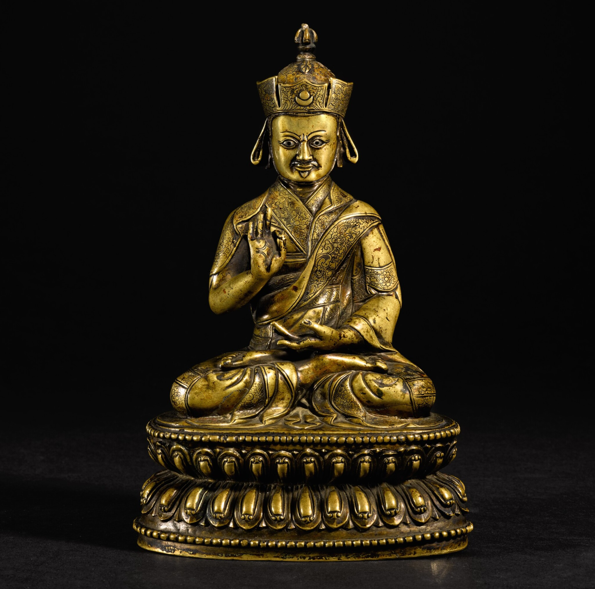 View 1 of Lot 189. A SILVER-INLAID COPPER-ALLOY FIGURE OF NYINGMAPA LAMA TIBET, 16TH/17TH CENTURY   十六/十七世紀 藏傳銅錯銀寧瑪派喇嘛坐像.