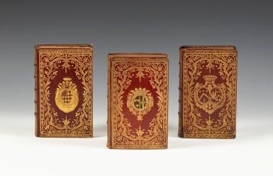 View 1. Thumbnail of Lot 1. Réunion de trois volumes en maroquin rouge aux armes ornés de plaque de Dubuisson..