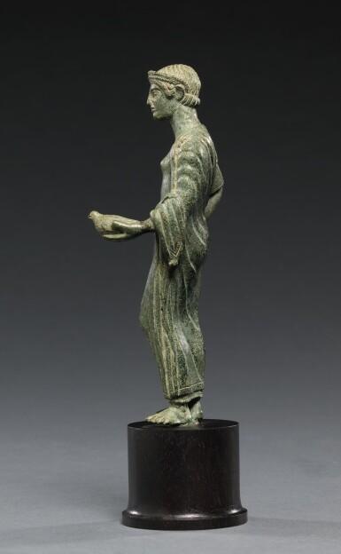 View 2. Thumbnail of Lot 11. AN ETRUSCAN BRONZE FIGURE OF A WOMAN, CIRCA 425-400 B.C..