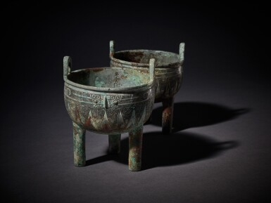 View 10. Thumbnail of Lot 1. An extremely rare pair of archaic bronze ritual food vessels (Ding), Late Shang dynasty   商末 子龔鼎一對.