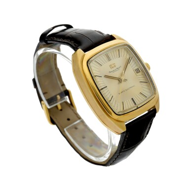 View 3. Thumbnail of Lot 92. REFERENCE R3003 A YELLOW GOLD TONNEAU SHAPED WRISTWATCH WITH DATE, CIRCA 1970.