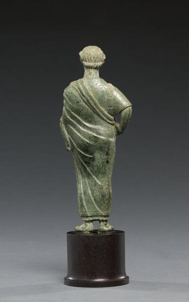 View 4. Thumbnail of Lot 11. AN ETRUSCAN BRONZE FIGURE OF A WOMAN, CIRCA 425-400 B.C..