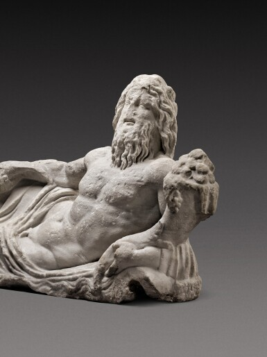 View 2. Thumbnail of Lot 68. A Roman Marble Fountain Figure of a River God, circa 2nd Century A.D..