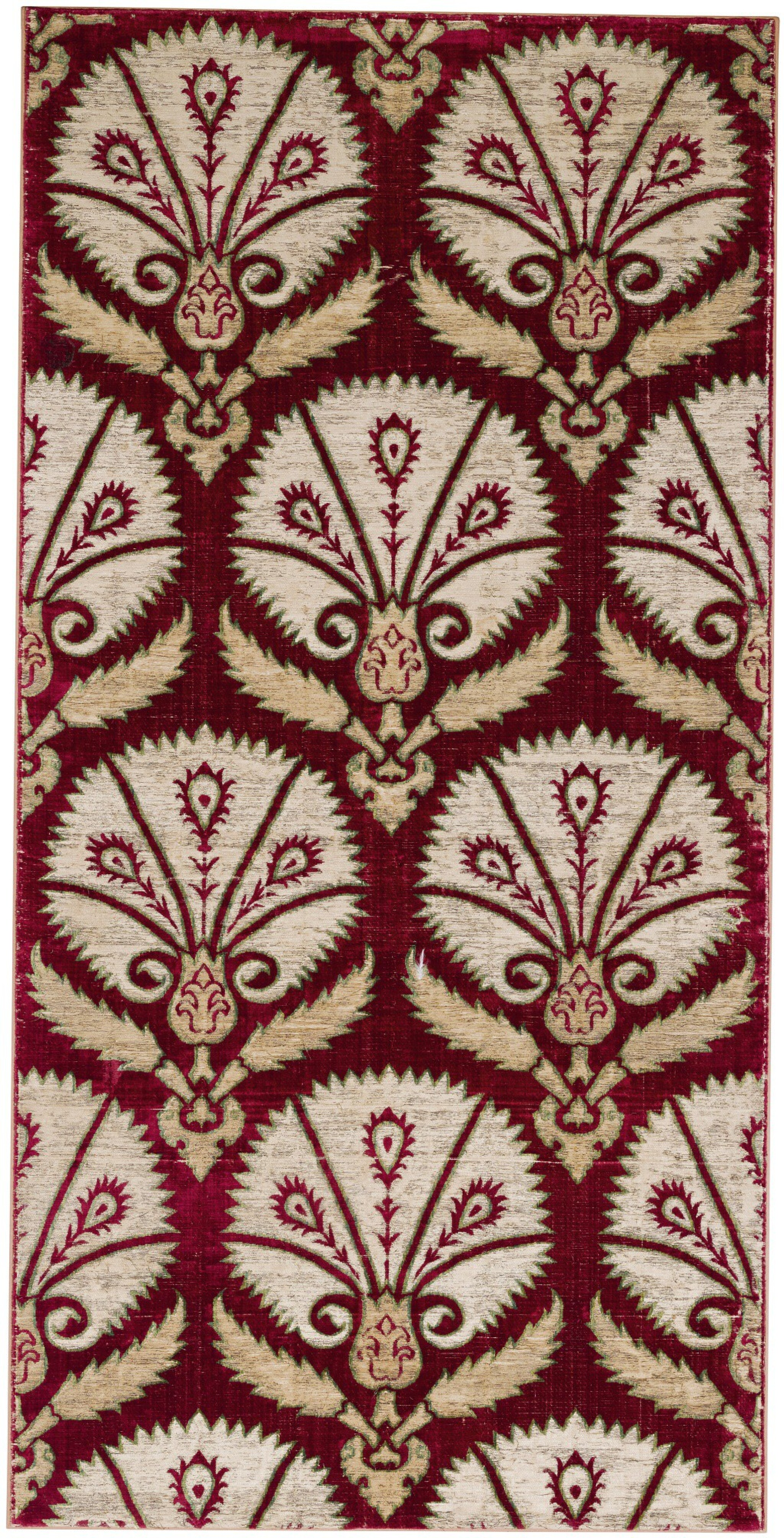 View full screen - View 1 of Lot 167. AN OTTOMAN VOIDED SILK VELVET METAL-THREAD (CATMA) PANEL WITH STYLISED PEACOCK FEATHERS WITHIN LARGE PALMETTES, TURKEY, BURSA OR ISTANBUL, EARLY 17TH CENTURY.