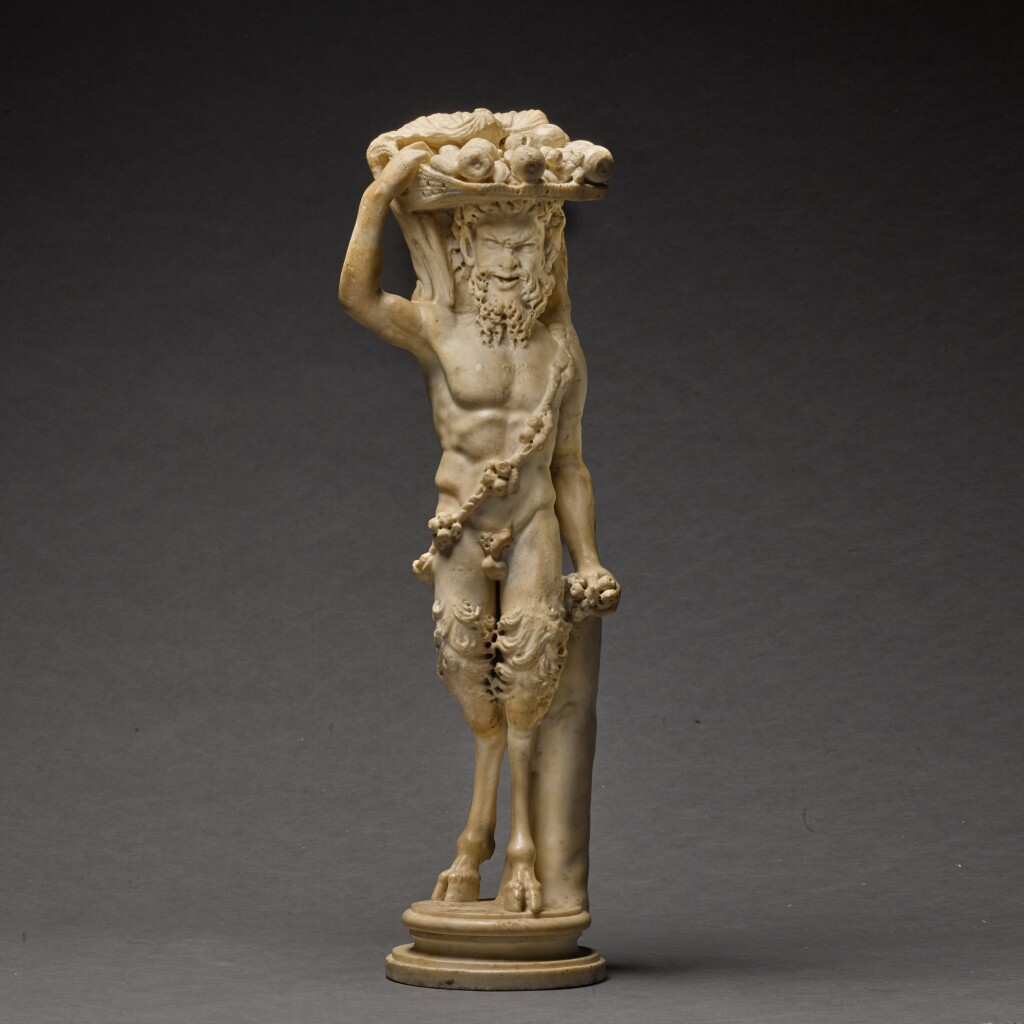 A ROMAN MARBLE FIGURE OF PAN, CIRCA 2ND CENTURY A.D., WITH CIRCA 18TH CENTURY RESTORATIONS